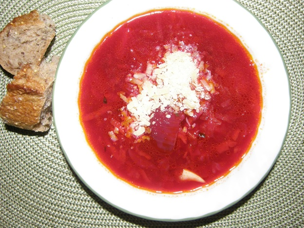 Vegetable soup topped with sour cream